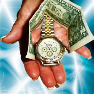 Wristwatch Bracelet Covered by Bill in Spectators Hand